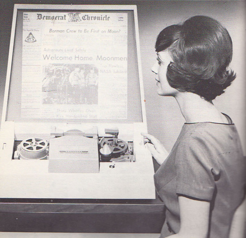 lady with retro hair using a microfilm reader
