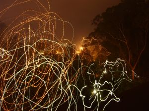 orange and yellow squiggly lights on dark background