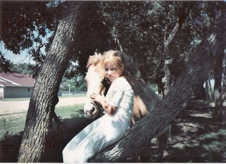 childhood me in a dress, in a tree, with Freckles