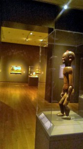 African sculpture in a gallery bordering French painting
